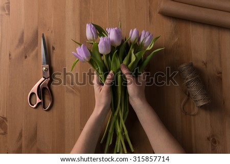 Process of making Tulip Bouquet. Photo from above the table - stock photo