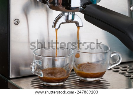 process of making two espresso shots using espresso machine