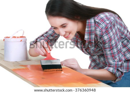 Process of painting the wood boards with the brush the paint - stock photo