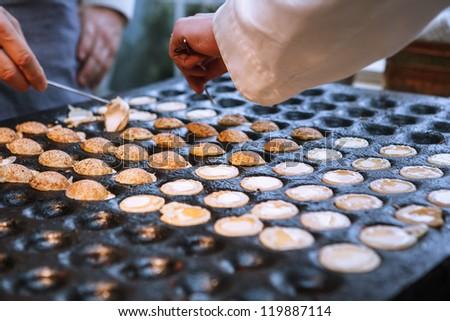 Process of poffertijes - traditional small Dutch pancakes-  making - stock photo