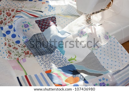 process of quilting on patchwork blanket - stock photo