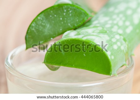 Process of receiving pure aloe gel for organic skincare and haircare - stock photo