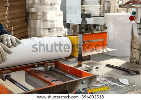 Process of various paper products manufacturing indoors - stock photo