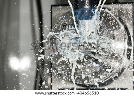 Processing / milling process of metal detail on CNC machine for heavy industry - stock photo