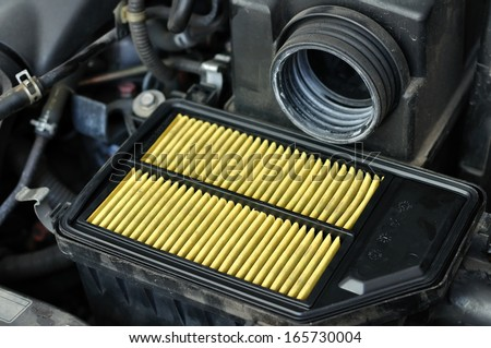 Processing to change engine air-filter at maintenance-center - stock photo