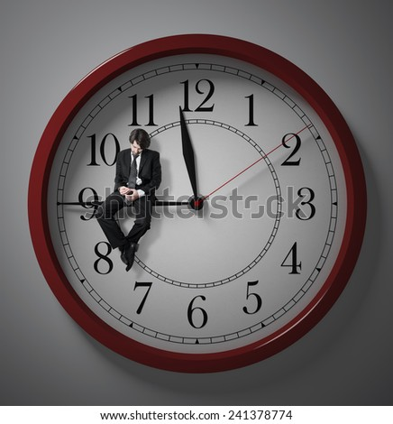 Procrastination. Waiting for the end of the working day. Stay at work. Deadline. wasting time. - stock photo