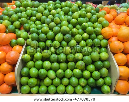 Produce market display of fresh limes, grapefruit and oranges