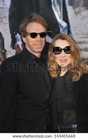 "Producer Jerry Bruckheimer & wife at the world premiere of his new movie ""The Lone Ranger"" at Disney California Adventure. June 22, 2013  Anaheim, CA - stock photo"