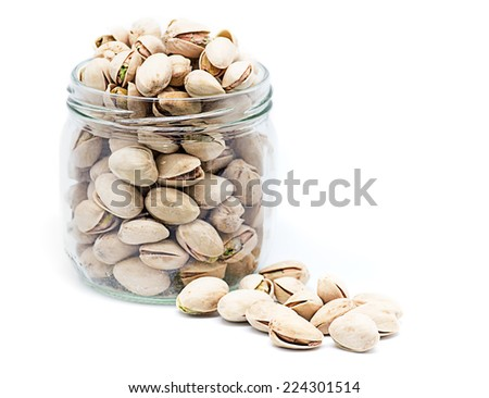product photography a jar full of pistachios on white background glass - stock photo