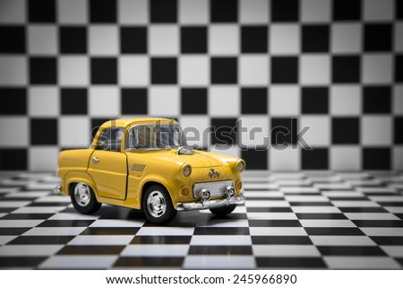 Product shot of Thunderbird Classic fifties scale model toy car from front view on checkered background.Shoot date and location:  January -14 2015. Turkey - Izmir - stock photo