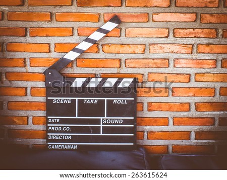 production clap on brick wall with vignette. - stock photo