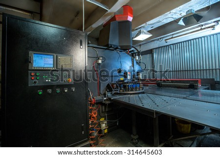 Production department. Machine for punching metal