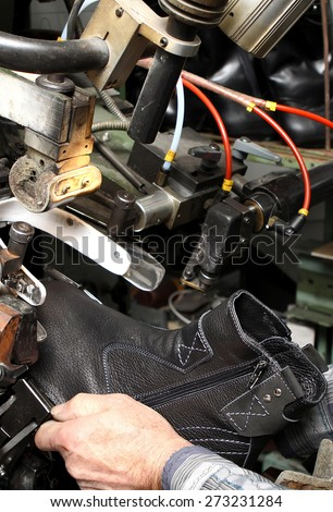 Production designer shoes. Footwear production by human hands. Shoe factory. - stock photo