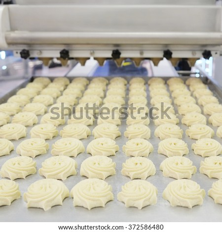 Production line at bakery - stock photo