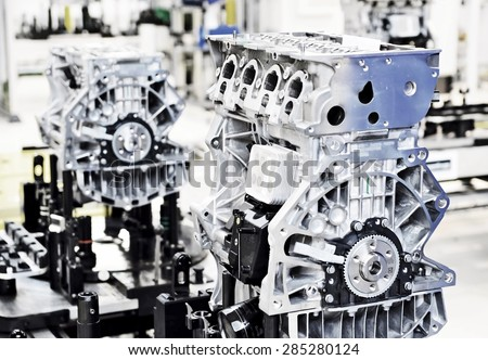 Production line for manufacturing of the engines in the car factory. - stock photo