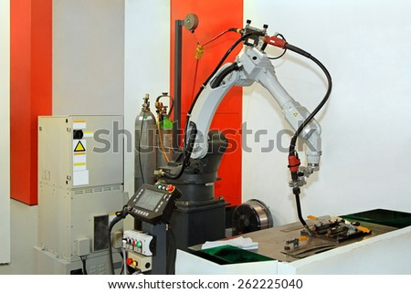 Production line with automatic plasma welding robot - stock photo