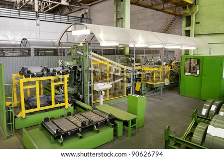 production machine for cutting metal plates - stock photo