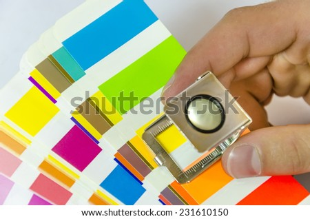 production of a printing. Print color palette loupe control - stock photo