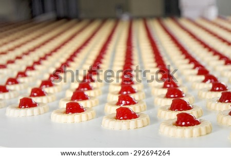 Production of biscuits inside of factory - stock photo