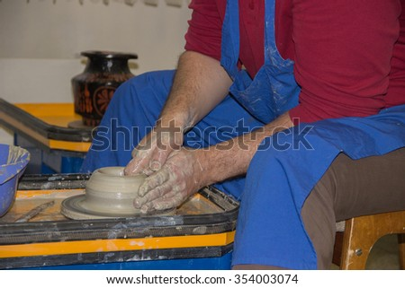 Production of ceramic vessel on the potter's wheel.