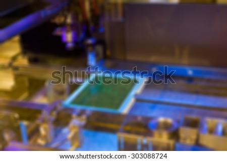 Production of electronic components  at high-tech factory blur background with bokeh - stock photo