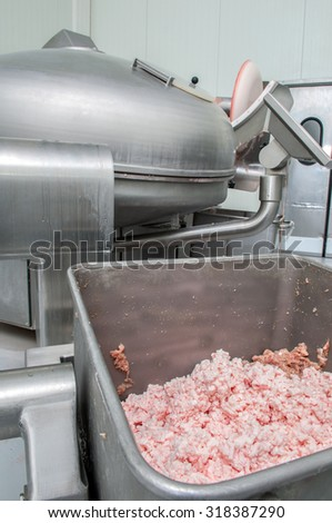 Production of sausage and ham in a meat factory - stock photo