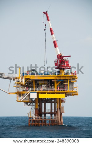 Production platform in offshore oil and gas industry. The platform with blue sky - stock photo