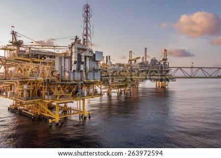 production platform rig in oil field when sunset - stock photo