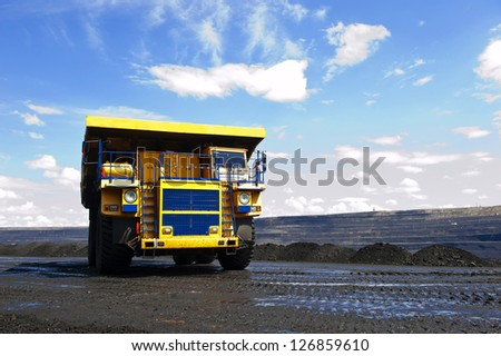 Production useful minerals. The dump truck. - stock photo