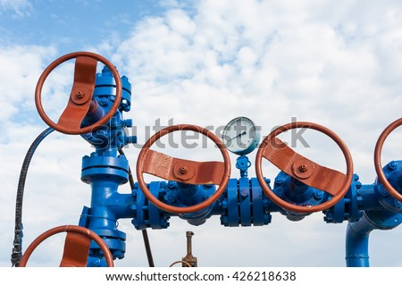 Production wellhead with valve armature. Oil, gas industry. - stock photo