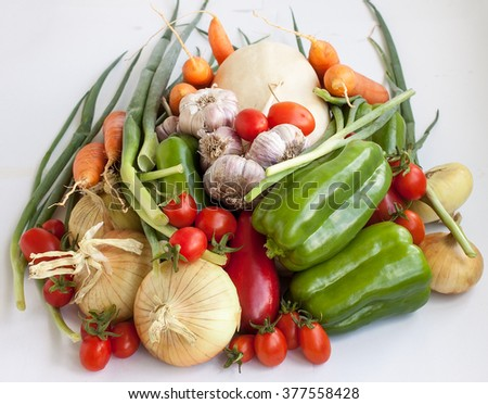 Products. A big crop of pure useful vegetables lie in a heap