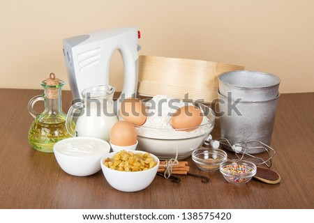 Products and baking dishes of Easter, means for ornament, on the beige