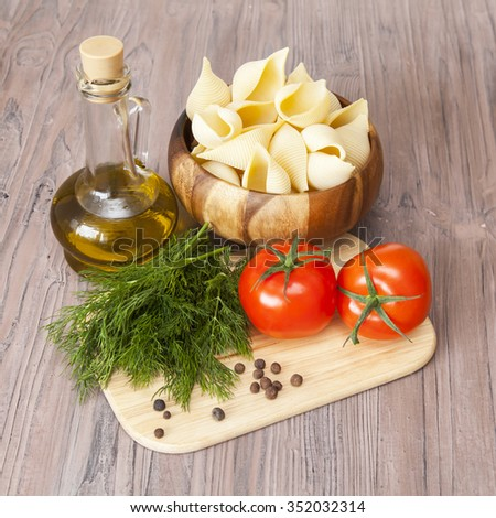 Products and kitchen utensils for cooking of paste with tomato sauce