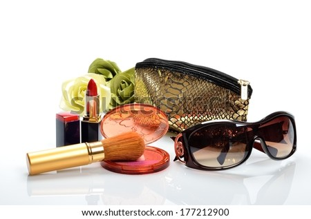 Products for decorative cosmetics, makeup and sunglasses - stock photo