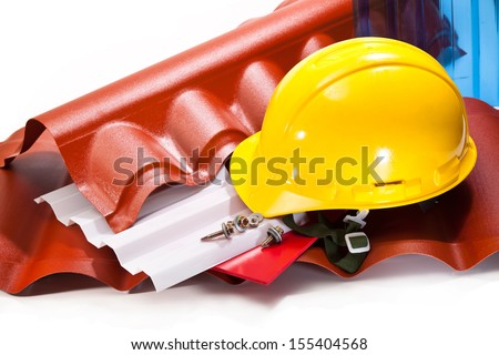 Products made of polycarbonate for roofing, a yellow hard hat, screws for mounting
