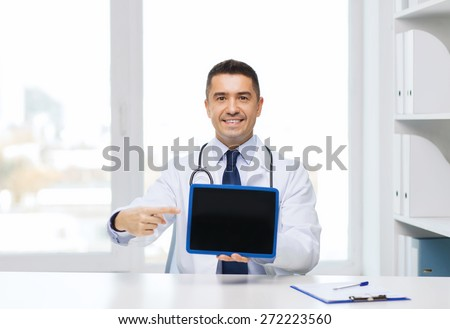 profession, people, technology, advertisement and medicine concept - smiling male doctor in white coat showing tablet pc computer blank screen in medical office - stock photo