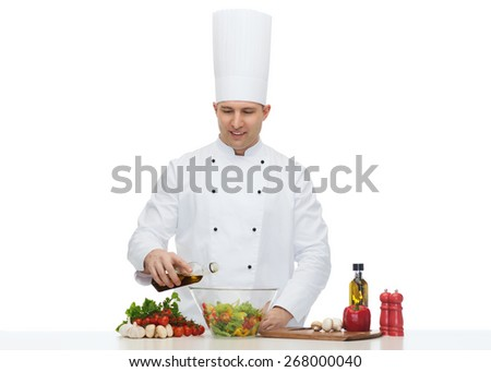 profession, vegetarian, food and people concept - happy male chef cooking salad - stock photo