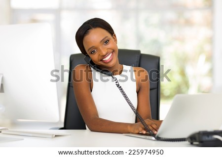 professional african american businesswoman working in modern office - stock photo