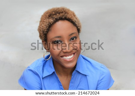 Professional and Attractive African American Business Woman Wearing a Blue Shirt  - stock photo