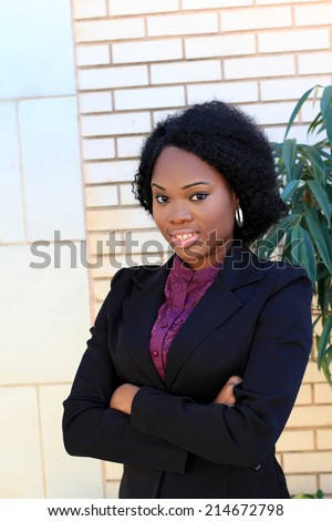 Professional and Attractive African American Business Woman Wearing Black Suit Arms Crossed