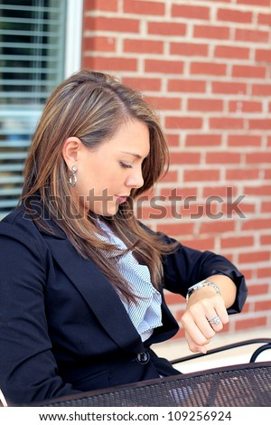 Professional and Attractive Brunette Business Woman Checking the Time - stock photo