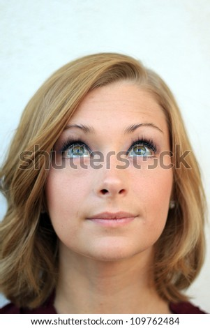 Professional and Attractive Business Woman Looking Up Serenely - stock photo