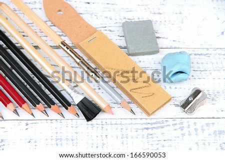 Professional art materials, on wooden table