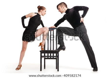professional artists dancing with chair over white - stock photo