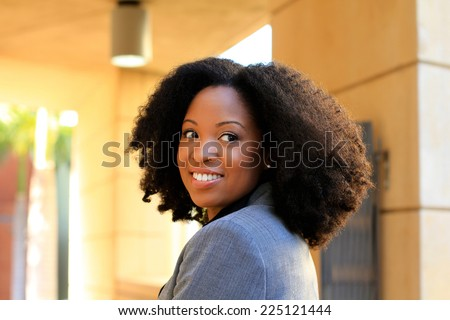 Professional Attractive African American Business Person With Black Hair Looking Back Smiling - stock photo