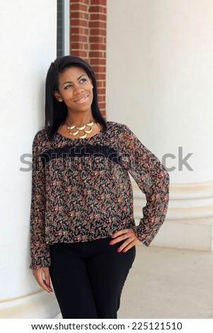 Professional Attractive African American Business Person With Black Hair Smiling and Happy Hand on Her Hip - stock photo