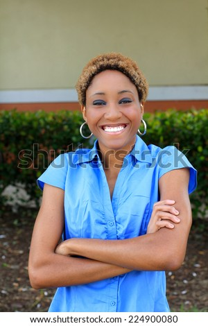 Professional Attractive African American Business Person Woman With Black Hair Happy Smiling Arms Crossed Blue Shirt - stock photo