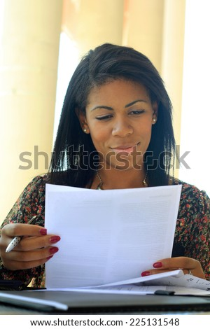 Professional Attractive African American Business Woman Person Black Hair Working on Paperwork  - stock photo