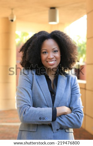 Professional Attractive African American Business Woman With Black Hair Arms Crossed