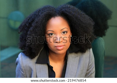 Professional Attractive African American Business Woman With Black Hair Wearing Suit Serious Expression - stock photo